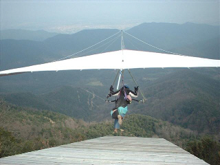 Judith flying a hang glider in 2003